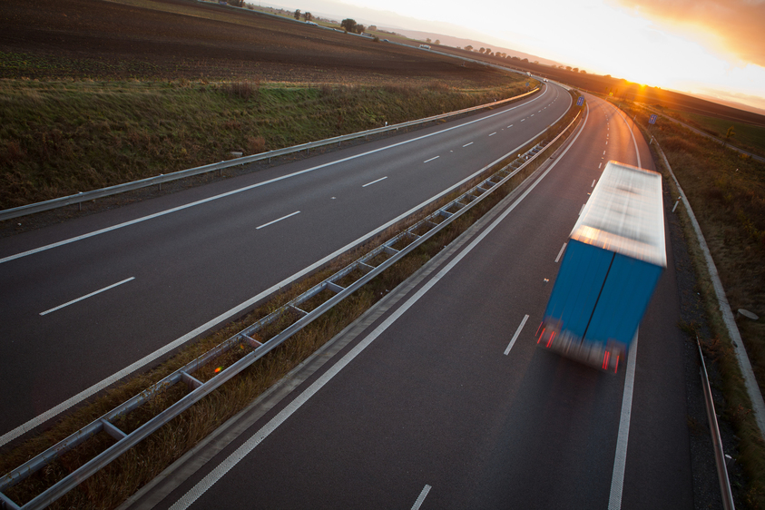 highway-traffic-motion-blurred-truck-on-a-highway-PRLRXAD.jpg