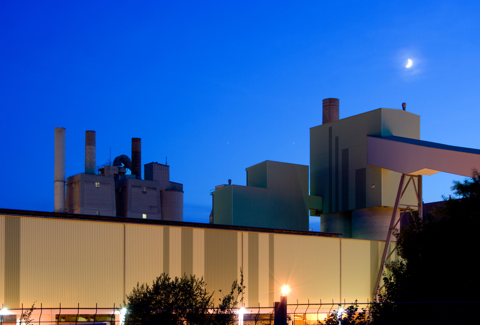 industrial-building-and-moon-at-night-PQNRZN5.jpg
